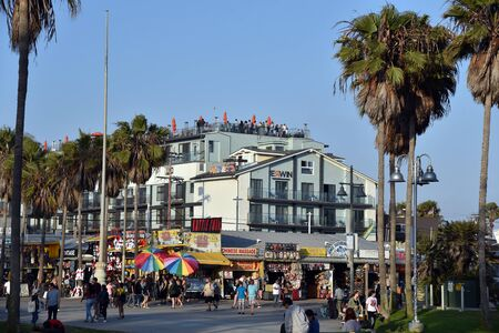 LOS ANGELES, CA/USA - JULY 5, 2019: Tourists crowd the famous Venice Beach Boardwalk on a beautiful summer day