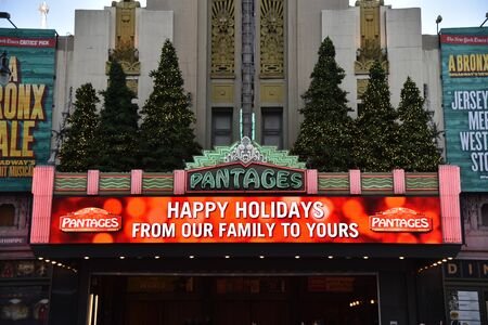 LOS ANGELES, CA/USA - November 24, 2018: Christmas trees adorn the marquee of the famous Pantages Theatre in Hollywood