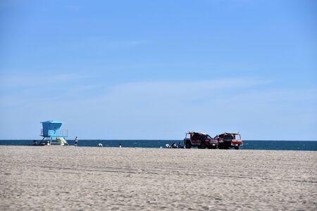 HUNTINGTON BEACH, CA/USA - Lifeguard hut and vehicles on the beach