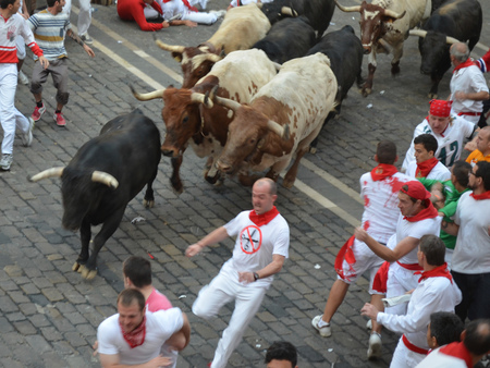 Crowds participate in the annual running of the bulls. San Fermin festival, Pamplona, Spain - July 10, 2013
