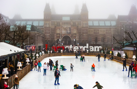 Dec 20, 2017 - People enjoying Ice skating in the gardens of the Rijksmuseum, Amsterdam, Netherlands Editorial