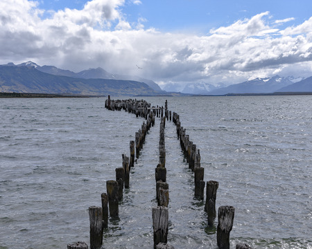 The Old Pier (Muelle Historico) in Almirante Montt Gulf in Patagonia - Puerto Natales, Magallanes Region, Chile Stock Photo
