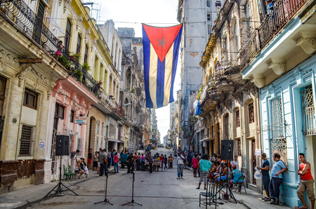 A Cuban flag hangs proudly from a balcony in the streets of Central Havana Editorial