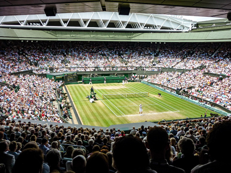 London, UK - July, 2014: A tennis match on Centre Court during the Wimbledon championships