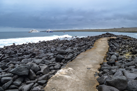 Volcanic rock along the coastline of Suarez Point, Espanola, in the Galapagos Islands Stock Photo