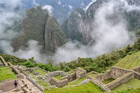 Stone built terracing and buildings at Machu Picchu, an ancient Inca archaeological site near Cusco, Peru Stock Photo