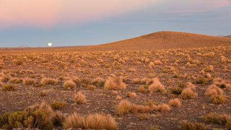 Partial Lunar eclipse over the Andean altiplano, Sud Lipez province, Eduardo Avaroa National Reserve, Bolivia Stock Photo