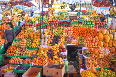 Arequipa, Peru - October 7, 2018: Fresh fruit and vegetable produce on sale in the central market, Mercado San Camilo Editorial