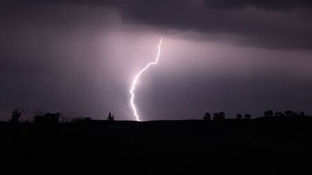A lightening bolt during a storm in the Andes mountains, Ayacucho, Peru Archivio Fotografico - 125044089