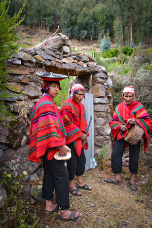 Sacred Valley, Cusco, Peru - Oct 13, 2018: A group of musicians in a rural Quechua community near  the Sacred Valley Editorial