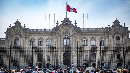 Lima, Peru - April 7, 2018: Tourists watch the Changing of the guards ceremony outside the Peruvian Government Palace