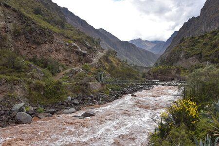 Bridge across the Urubamba river at the start point of the Inca Trail to Machu Picchu. Cusco, Peru