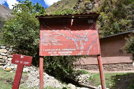Cusco, Peru - Oct 18, 2018: SIgn welcoming hikers to Huayllabamba on the Inca Trail to Machu Picchu