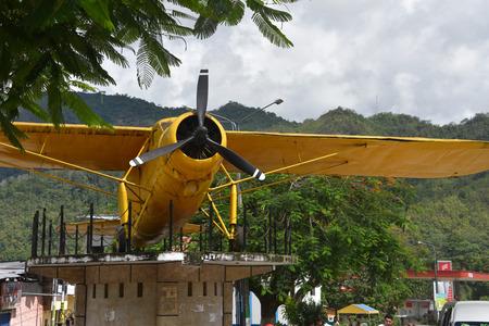 San Ramon, Junin, Peru - Dec 30, 2018: An old Biplane stands as a memorial in Parque del Avion, San Ramon Publikacyjne