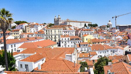 Lisbon, Portugal - July 23, 2019: Summertime views across the rooftops of the Alfama district 스톡 콘텐츠 - 129485439