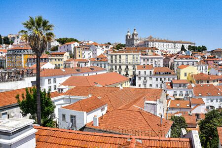 Lisbon, Portugal - July 23, 2019: Summertime views across the rooftops of the Alfama district 스톡 콘텐츠 - 129485449