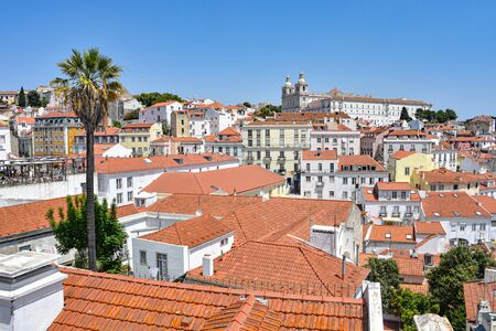 Lisbon, Portugal - July 23, 2019: Summertime views across the rooftops of the Alfama district 스톡 콘텐츠 - 129485456