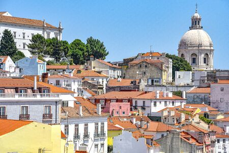 Lisbon, Portugal - July 23, 2019: Summertime views across the rooftops of the Alfama district 스톡 콘텐츠 - 129485462