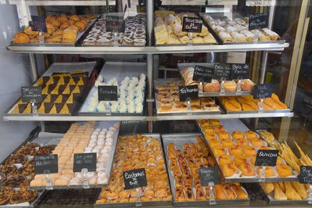 Lisbon, Portugal - July 27, 2019: Pasteis de Nata and traditional pastries on sale in a Lisbon bakery