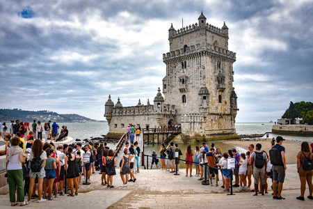 Lisbon, Portugal - July 26, 2019: Crowds of tourists at the entrance to Belem Tower