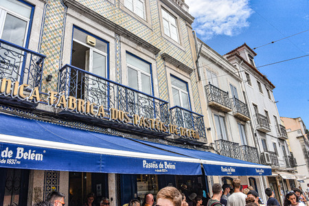Lisbon, Portugal - July 26, 2019: Crowds of visitors outside the Pasteis de Belem bakery and cafe in Lisbon