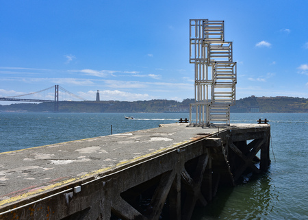 Lisbon, Portugal - July 26, 2019: Modern art sculpture on the banks of the Tagus River in Belem