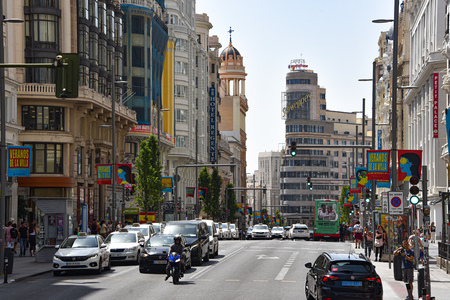 Madrid, Spain - July 22, 2019: Calle Gran Via and the Carrion Building (Capital Building)