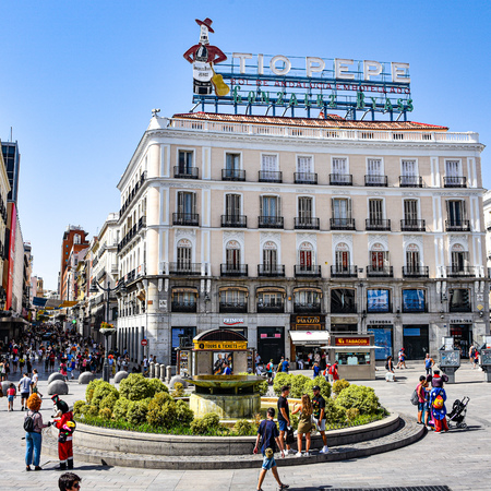Madrid, Spain -July 22, 2019: Neon sign above Puerta del Sol public square 에디토리얼