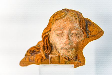 Lisbon, Portugal - July 26, 2019: A segment of a ceramic pot depicting Jesus Christ, on display at the Sao Jorge Castle Museum 報道画像