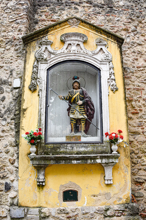 Lisbon, Portugal - July 27, 2019: Statue of Saint George in the entrance of the Sao Jorge (St. George) Castle 에디토리얼