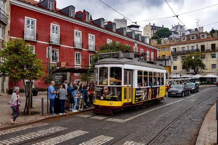 Lisbon, Portugal - July 27, 2019: Trams providing mass public transportation in the Alfama district of Lisbon, Portugal