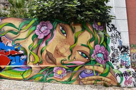 Lisbon, Portugal - July 27, 2019: Examples of colorful Graffiti art on the streets of Lisbon