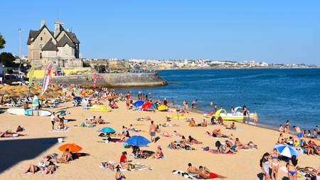 Cascais, Lisbon, Portugal - July 24, 2019: Bathers enjoying hot summer weather on the beaches of Cascais
