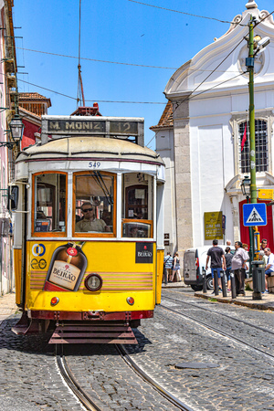Lisbon, Portugal - July 27, 2019: Trams providing mass public transportation in the Alfama district of Lisbon, Portugal