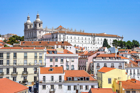 Lisbon, Portugal - July 23, 2019: Summertime views across the rooftops of the Alfama district 스톡 콘텐츠 - 129476669
