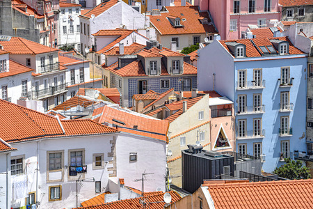 Lisbon, Portugal - July 23, 2019: Summertime views across the rooftops of the Alfama district