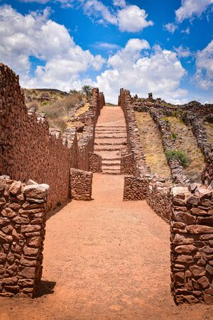 Ancient walls and buildings dating back to the Wari culture, at the Pikillacta archaeological site, just south of Cusco, Peru