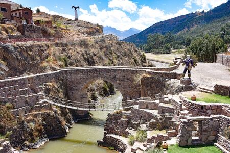 Colonial bridges spanning the river in Checacupe, Cusco, Peru