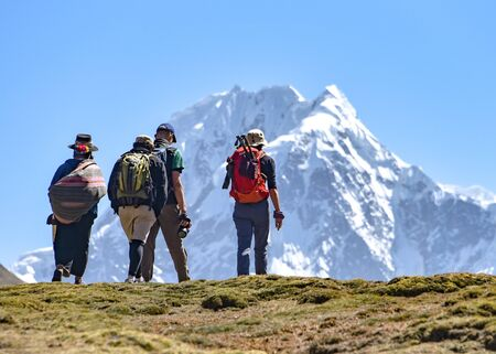 A group of trekkers on the Ausungate trail in the Peruvian Andes Stock Photo