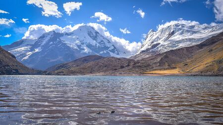 The turqoise waters of Lago Cochajasa at the foot of Mt Ausangate. Cusco, Peru