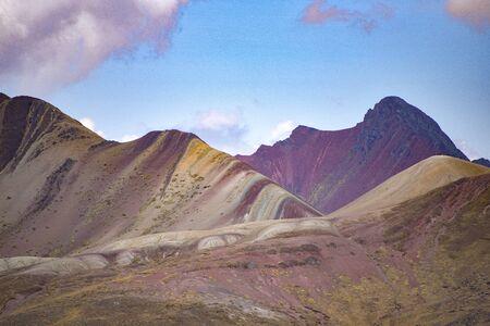 Views of the Vinicuna 'rainbow mountain' from a distance. Cordillera Vilcanota, Cusco, Peru