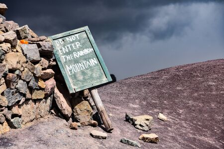 A sign informing tourists not to enter the Vinicunca Rainbow Mountain. Cusco, Peru