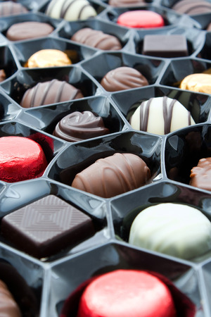 angled view: Box of chocolates at an angled overhead view with a shallow depth of field