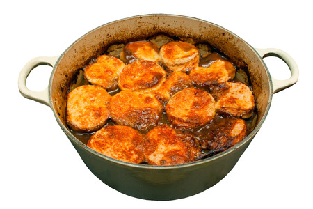 gastro: Beef stew and dumplings in a pan on an isolated white background Stock Photo