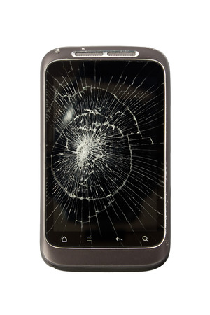 scuffed: Broken mobile phone with a cracked screen and scuffed case on isolated white background
