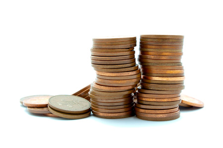 white interest rate: Crooked pile of copper coins with others around the base