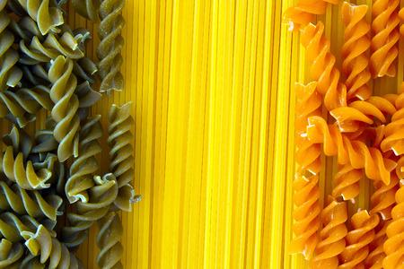 fusilli: Raw pasta arrangement with spaghetti and red and green fusilli Stock Photo