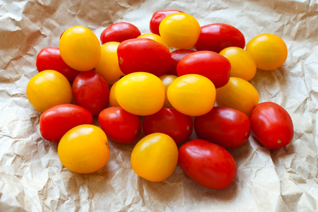 tomato: Red and yellow cherry tomatoes in a brown crumpled up paper bag Stock Photo