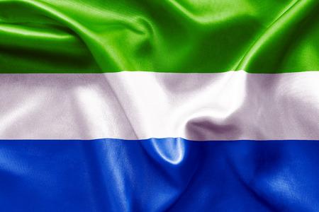 sierra: Sierra Leone flag texture crumpled up Stock Photo