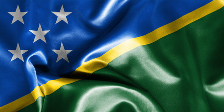 creased: Solomon Islands flag texture creased and crumpled up with light and shadows